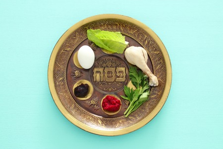 Foto de Pesah celebration concept (jewish Passover holiday). Traditional pesah plate with five symbols: horseradish, celery, egg, bone, maror, charoset - Imagen libre de derechos