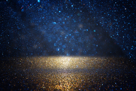 Foto de glitter vintage lights background. black, blue and gold. de-focused - Imagen libre de derechos