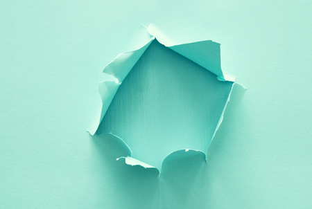 Photo for Mint pastel color background with hole in the paper. Copy space - Royalty Free Image