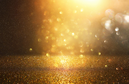 Foto de glitter vintage lights background. black and gold. de-focused - Imagen libre de derechos