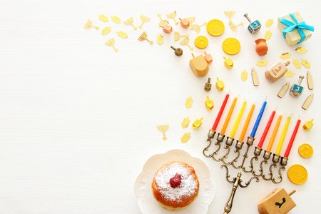 Photo for Top view image of jewish holiday Hanukkah background with traditional spinnig top, menorah (traditional candelabra) and candles - Royalty Free Image