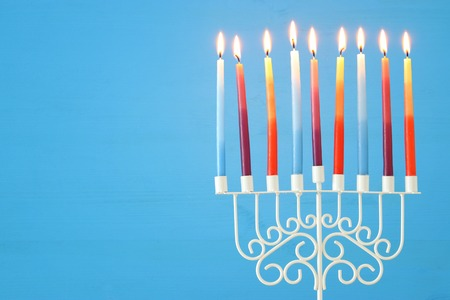 Photo for image of jewish holiday Hanukkah background with menorah (traditional candelabra) and colorful candles - Royalty Free Image