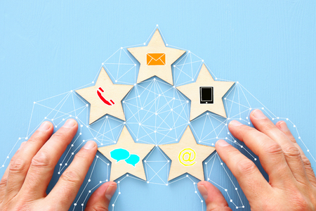 Foto de Concept of setting five star customer service rating. Contact us business idea - Imagen libre de derechos
