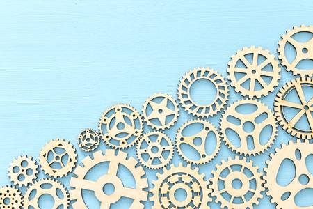 Photo pour Working system of cogwheels, teamwork, flat lay, pastel yellow background - image libre de droit