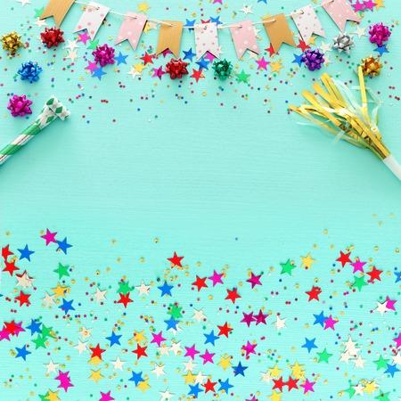 Foto de Party colorful confetti over light pastel blue wooden background . Top view, flat lay - Imagen libre de derechos
