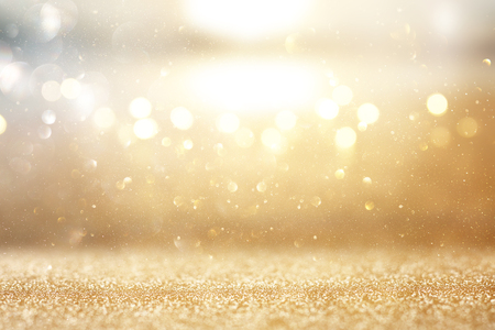 Foto de Photo of gold and silver glitter lights background - Imagen libre de derechos