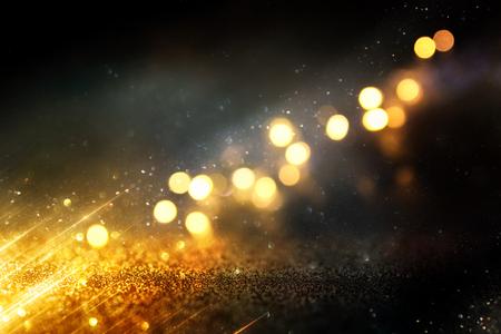Photo pour Glitter vintage lights background. Black and gold. De-focused. - image libre de droit