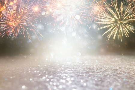 Foto de abstract gold and silver glitter background with fireworks. christmas eve, 4th of july holiday concept - Imagen libre de derechos