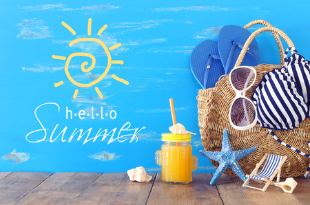 vacation and summer concept with sea life style objects and fresh fruit drink over wooden table