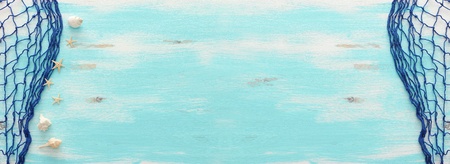 Foto de Top view of Fishnet on pastel blue wooden background. Top view, flat lay. Banner - Imagen libre de derechos