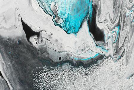 Foto de Photography of abstract marbleized effect background. Black, light turquoise and white creative colors. Beautiful paint - Imagen libre de derechos