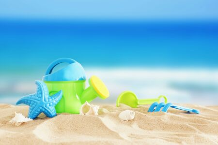 Foto de Vacation and summer image with beach colorful toys for kid over the sand - Imagen libre de derechos