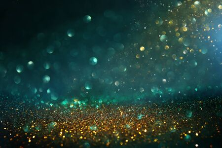 Foto de Abstract glitter lights background. Black, blue, gold and green. De-focused - Imagen libre de derechos