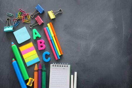 Foto de Education and back to school concept. Stationery over classroom blackboard. Top view, flat lay - Imagen libre de derechos