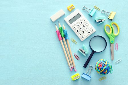 Foto de Education and back to school concept. Stationery over wooden blue background. Top view, flat lay - Imagen libre de derechos