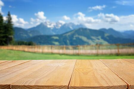 Foto de Empty table in front of blurry nature and mountains background. Ready for product display montage - Imagen libre de derechos