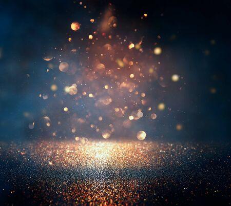 Foto de blackground of abstract glitter lights. blue, gold and black. de focused - Imagen libre de derechos