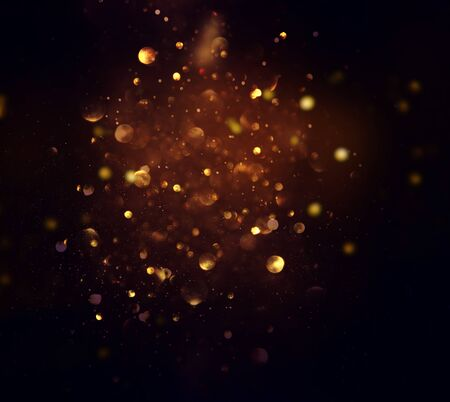 Photo for blackground of abstract glitter lights. blue, gold and black. de focused - Royalty Free Image