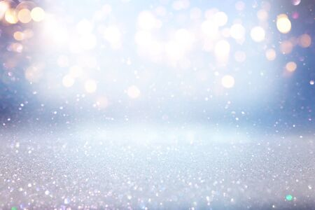 Photo pour background of abstract glitter lights. blue, gold and silver. de focused - image libre de droit