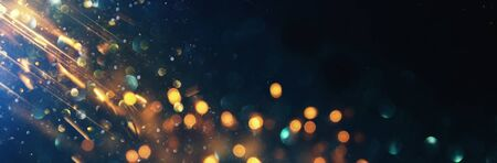 Photo for background of abstract glitter lights. blue, gold and black. de focused. banner - Royalty Free Image