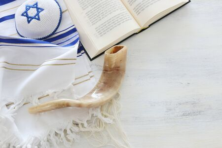 Photo for religion image of Prayer Shawl - Tallit, Prayer book and Shofar (horn) jewish religious symbols. Rosh hashanah (jewish New Year holiday), Shabbat and Yom kippur concept. - Royalty Free Image