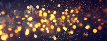 Photo for background of abstract glitter lights. gold and black. de focused. banner - Royalty Free Image