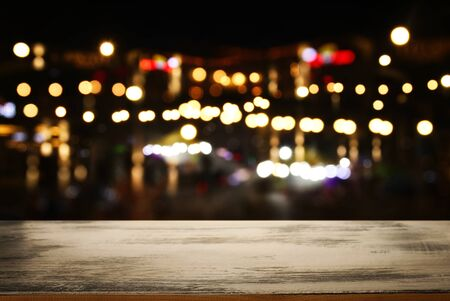 Photo pour background Image of wooden table in front of abstract blurred restaurant lights - image libre de droit