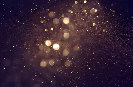 Photo for background of abstract glitter lights. gold and black. de focused - Royalty Free Image