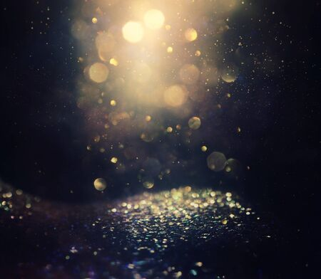 Photo pour background of abstract glitter lights. gold and black. de focused - image libre de droit