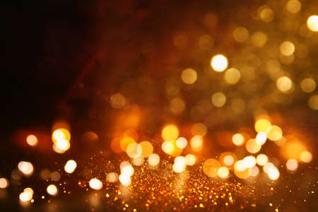 Photo pour background of abstract gold and black glitter lights. defocused - image libre de droit