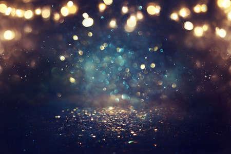 Photo pour background of abstract glitter lights. gold, blue and black. de focused - image libre de droit