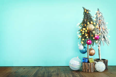 Photo pour Image of christmas tree with decorations in front of pastel blue background - image libre de droit