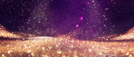 Photo for background of abstract glitter lights. Gold ,purple and black. de focused - Royalty Free Image