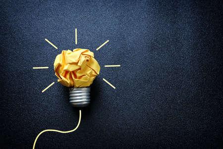 Photo pour Education concept image. Creative idea and innovation. Crumpled paper as light bulb metaphor over black background - image libre de droit