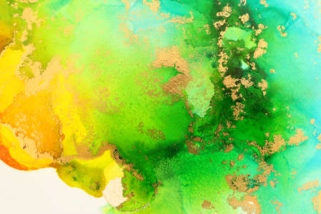 Foto de art photography of abstract fluid art painting with alcohol ink, ocean colors, green, turquoise, blue and gold - Imagen libre de derechos