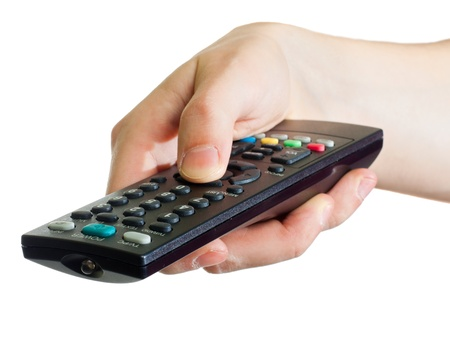 Photo pour A male hand holding a remote control, isolated on white - image libre de droit