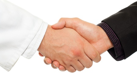 Photo pour Handshake between a businessman and a doctor, isolated on white. - image libre de droit