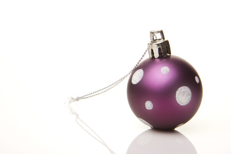 pink christmas bauble with pattern isolated with white