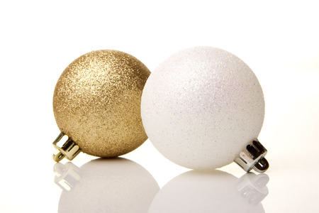 christmas, golden and white christmas baubles  isolated with white background