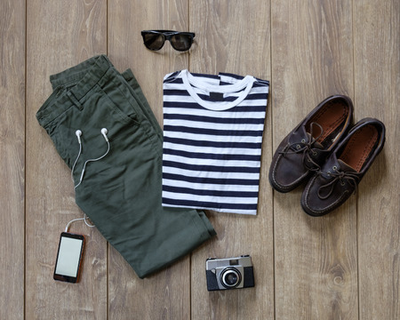 hipster casual clothes and accessories on a wooden background