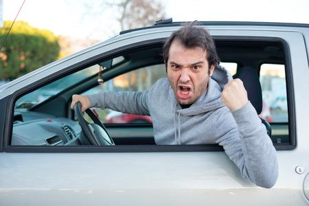 Photo pour Portrait of angry driver at the wheel. Negative human emotions face expression - image libre de droit