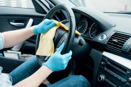 Foto de Man cleaning his car interiors and wheel - Imagen libre de derechos