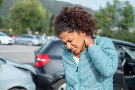 Photo pour Painful whiplash after fender bender car crash - image libre de droit