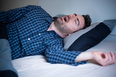 Photo for Man snoring and suffering sahs at night - Royalty Free Image