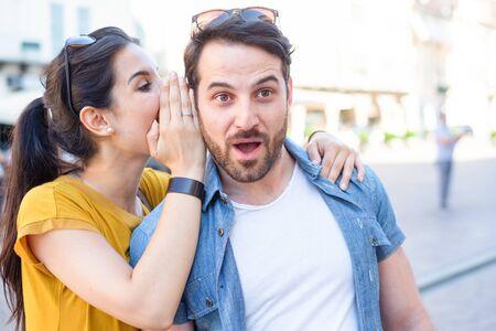 Photo pour Woman is whispering I love you into his boyfriends ear - image libre de droit