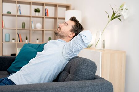 Photo pour Lazy day off. Man resting sitting on sofa and taking a break - image libre de droit