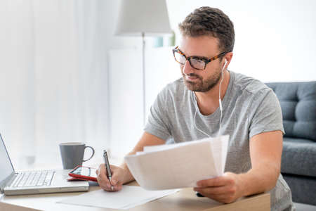 Man working from home using computer and internet connection