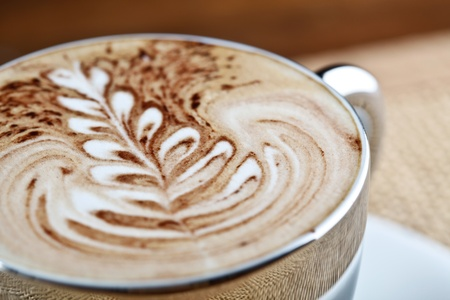 art latte on a cappuccino coffe cup