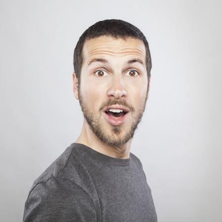 Foto de portrait of a young beautiful man surprised face expression - Imagen libre de derechos