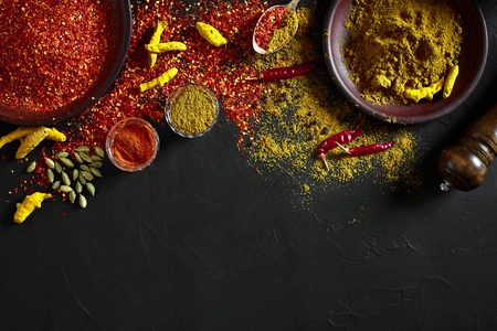 Exotically Spice Mix - spice, herbs, powder top view over dark background. Cooking and spicy food concept. Copy space